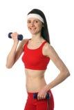 Giovane donna felice che si esercita con i dumbbells Immagini Stock Libere da Diritti