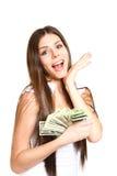 Giovane donna felice che tiene i dollari su un fondo bianco Fotografie Stock