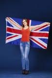Giovane donna felice che tiene una bandiera di Florida britannica della Gran Bretagna Fotografia Stock