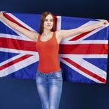 Giovane donna felice che tiene una bandiera di Florida britannica della Gran Bretagna Immagini Stock