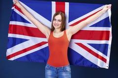 Giovane donna felice che tiene una bandiera di Florida britannica della Gran Bretagna Immagini Stock Libere da Diritti