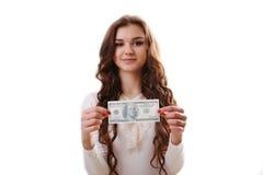 Giovane donna felice con i dollari a disposizione sopra l'immagine - una citazione dal presidente John F Immagine Stock Libera da Diritti