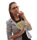 Giovane donna felice con i dollari a disposizione sopra l'immagine - una citazione dal presidente John F Immagini Stock