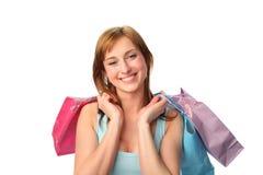 Giovane donna felice con i sacchetti di acquisto fotografie stock