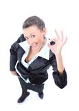 Giovane donna felice di affari che fa segno giusto Fotografie Stock