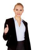 Giovane donna felice di affari con il pollice su Immagini Stock
