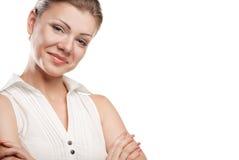 Giovane donna felice di affari con la mano piegata Fotografia Stock