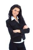 Giovane donna felice di affari con la mano piegata immagine stock