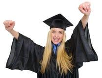 Donna felice nel successo di esultanza dell'abito di graduazione Fotografie Stock Libere da Diritti