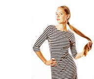 Giovane donna graziosa in vestito elegante dalla striscia isolato su bianco Fotografia Stock Libera da Diritti