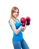 Giovane donna nei guanti di inscatolamento Fotografia Stock