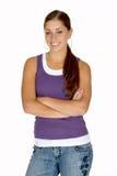 Giovane donna nella parte superiore di serbatoio di Puple con le braccia piegate Immagine Stock Libera da Diritti