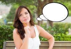 Giovane donna premurosa con la matita e la bolla in bianco di pensiero Immagine Stock Libera da Diritti