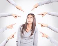 Giovane donna preoccupata che è accusata Immagine Stock Libera da Diritti