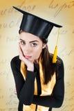 Giovane donna preoccupata sul suo giorno di laurea Fotografie Stock