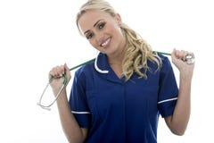 Giovane donna rilassata attraente che posa come un medico o infermiere Fotografia Stock