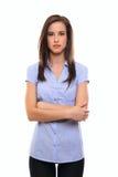 Giovane donna seria isolata su bianco Fotografia Stock