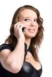 Giovane donna sexy che parla sul telefono mobile Fotografie Stock
