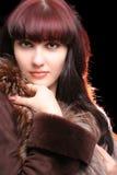 Giovane donna sexy con indicatore luminoso lunatico Fotografie Stock