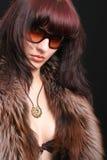 Giovane donna sexy con indicatore luminoso lunatico Fotografia Stock Libera da Diritti