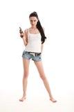 Giovane, donna sexy con la pistola. Fotografia Stock