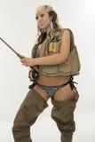 Giovane donna sexy con le attrezzature di pesca fotografia stock