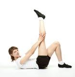 Giovane donna snella che fa gli esercizi di sport Fotografia Stock Libera da Diritti