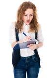 Giovane donna sorpresa di affari con la penna e compressa per le note Fotografia Stock Libera da Diritti