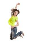 Salto sorridente della giovane donna Immagine Stock Libera da Diritti
