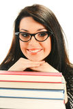 Giovane donna sorridente con i libri su bianco Fotografia Stock Libera da Diritti