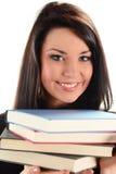 Giovane donna sorridente con i libri su bianco Immagini Stock Libere da Diritti