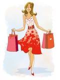 Giovane donna sorridente con i sacchetti della spesa Fotografia Stock Libera da Diritti