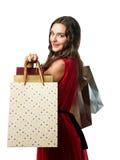 Giovane donna sorridente con i sacchetti di acquisto Fotografia Stock