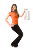 Giovane donna sorridente con il sacchetto bianco fotografia stock libera da diritti