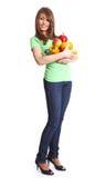 Giovane donna sorridente con la frutta fotografia stock
