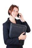 Giovane donna sorridente di affari con il telefono astuto Immagini Stock