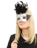 Giovane donna nella maschera Fotografia Stock