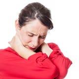 Giovane donna sottolineata che soffre dalla rigidezza del collo Fotografia Stock Libera da Diritti