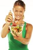 Giovane donna su priorità bassa bianca con un'insalata Fotografia Stock