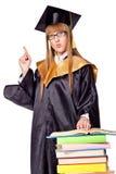 Giovane donna sveglia in un abito di graduazione Fotografia Stock