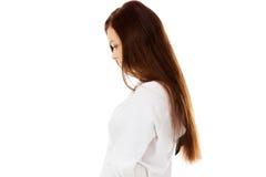 Giovane donna triste con la sua testa giù Fotografia Stock