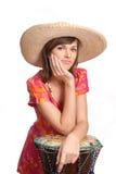 Giovane donna in un cappello di paglia Fotografia Stock Libera da Diritti