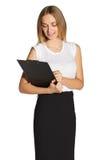 Giovane donna in un vestito con una lavagna per appunti Immagini Stock