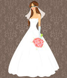 Giovane donna in un vestito da cerimonia nuziale Fotografia Stock