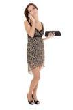 Giovane donna in un vestito per i cocktail immagini stock libere da diritti