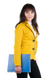 Giovane donna in vestito giallo con il dispositivo di piegatura dell'ufficio. Fotografie Stock Libere da Diritti