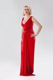 Giovane donna in vestito rosso Fotografie Stock