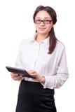 Giovane donna in vetri con un calcolatore Immagini Stock Libere da Diritti