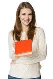 Giovane donna vi che dà un libro immagini stock