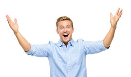 Giovane felice che celebra successo su fondo bianco Fotografie Stock Libere da Diritti